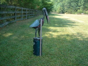 TIN-030 PELICAN ON POST